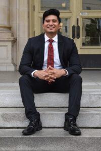 Smiling on the steps e1569897271762 200x300 - Manny Delgado with Delgado Insurance