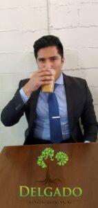 Manny drining Coffee with Logo 142x300 - Manny Delgado with Delgado Insurance